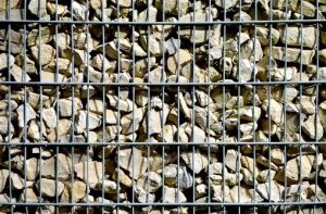 Schanskorven grondkleding gevelbekleding urnenmuur breuksteen